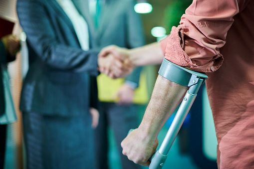 Injured person shaking hands