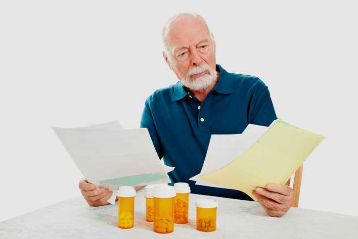 A man contemplates overdue medical bills